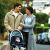 670_mother-and-father-look-at-each-other-whilst-pushing-baby-in-buggy